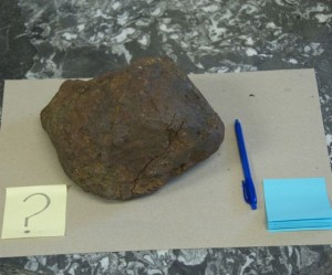 A mystery rock, a possible meteorite, rests on a table in the Geology Department's administrative offices. Photo by Dirk Van Susteren
