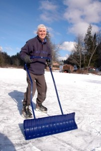 Don Heise is a familiar sight on Curtis Pond near Maple Corner in Calais. Heise has created a vibrant winter recreation community with his unstinting passion for making ice and keeping it clear on the pond. Photo by Andrew Nemethy
