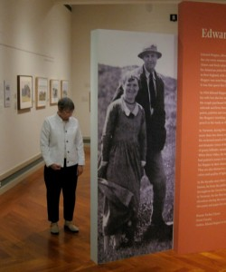 "In an-almost life-size reproduction of a 1934 photograph, Edward Hopper towers over his wife, Jo. Their portrait welcomes viewers to ""Edward Hopper in Vermont,"" an exhibition at the Middlebury College Museum of Art through Aug. 11. Photo by Nancy Price Graff"