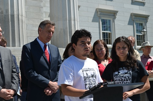 Danilo Lopez (center) speaks before Gov. Peter Shumlin signs S.38. Natalia Fajardo translates. Photo by Alicia Freese/VTDigger