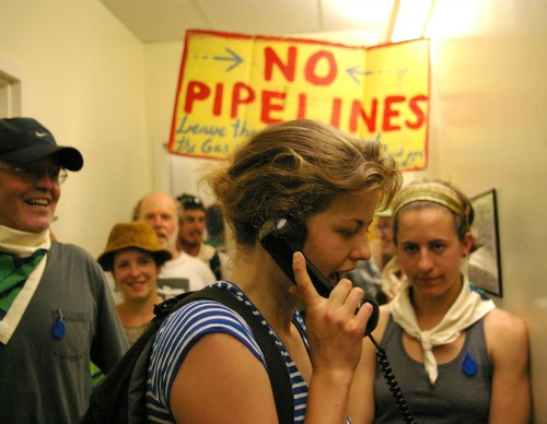Anna Shireman-Grabowski, a member of Rising Tide Vermont and a Middlebury College student, calls the Department of Public Service Monday afternoon to let them know protesters are at their door with a demand to halt Vermont Gas Systems' proposed natural gas pipeline in Addison County. Photo by Andrew Stein