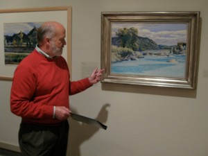 Richard Saunders, director of the Middlebury College Museum of Art, points out how Hopper in 1938 used the abstract shapes of heavy clouds, leaning trees, the river's current, the undulations of the hillside, and the protruding rocks to create composition full of energy and movement. Photo by Nancy Price Graff