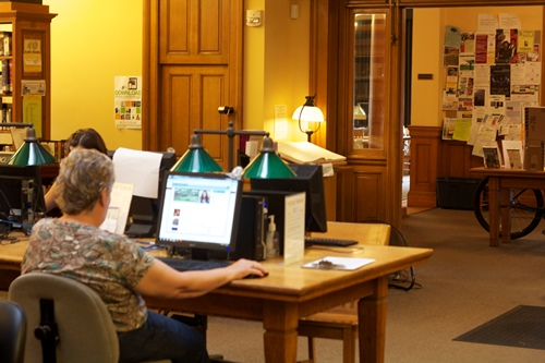 Patrons use public computers at the Kellogg-Hubbard Library in Montpelier. Photo by Viola Gad/VTDigger