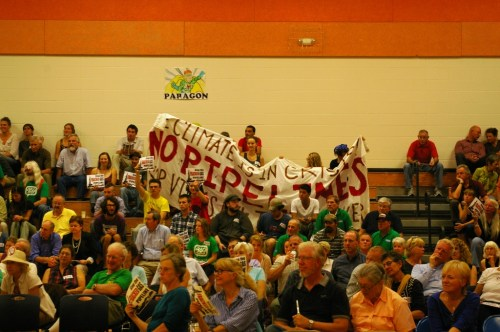 Opponents of the pipeline project raise a banner Wednesday, Photo by Andrew Stein/VTDigger