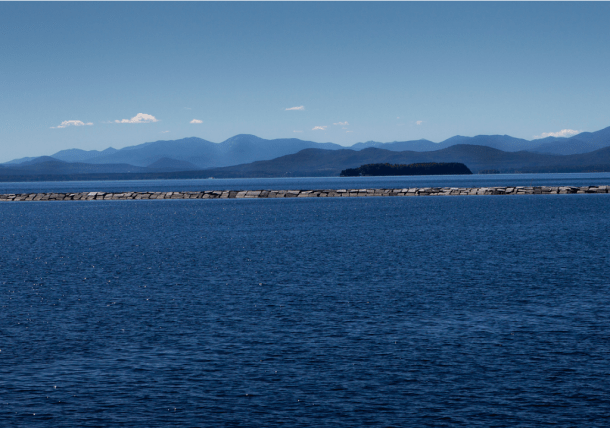 Lake Champlain and the Adirondack Mountains in New York as seen from the waterfront in Burlington. Photo by Roger Crowley/for VTDigger