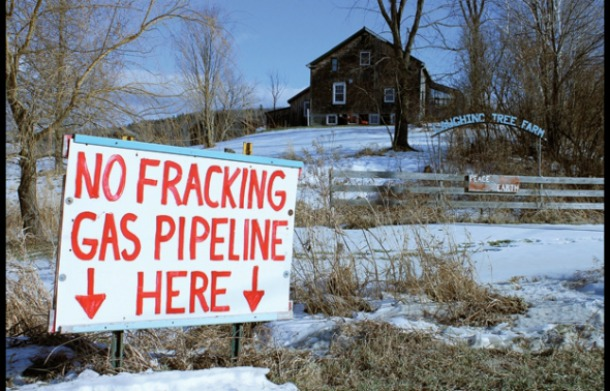 AN SIGN STANDS in the yard of Jane and Nathan Palmer of Monkton, who are fighting to keep a natural gas pipeline from being built on their property. Independent photo/Zach Despart