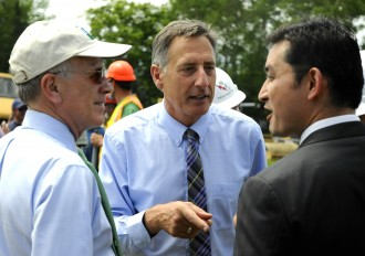 Congressman Peter Welch, D-Vt., Gov. Peter Shumlin and Ary Quiros, CEO of Q Burke Mountain, joke at a groundbreaking ceremony for the ski resort in June 2014. Photo by Hilary Niles/VTDigger