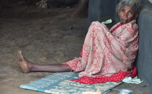 Elderly Gond woman in a village where police say two girls 'surrendered'.
