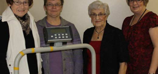 Standing behind the new roll-on scale at Pleasant View Care Home in Wadena are (left to right) Miriam Gair, Frances Zagrodney and Barb Kereluke with Bonnie Scrimbitt, assistant manager at Wadena Hospital/ Pleasant View Care Home. Through ongoing fundraising, the auxiliary raised the majority of funds to purchase the scale, which cost just under $3000.