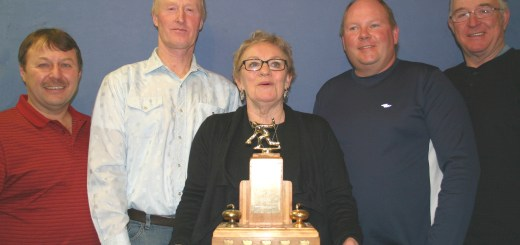 Ellen Comfort presented Thoen's Ram Tough Super League champions with the trophy. The team is, left to right, Brent Franko (skip), Bruce Brownlee, Collin Redman and Al Wheatley. (Photo Pat Casement)