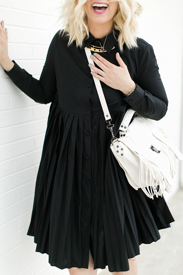 Black everyday dress with pleats and white fringe bag