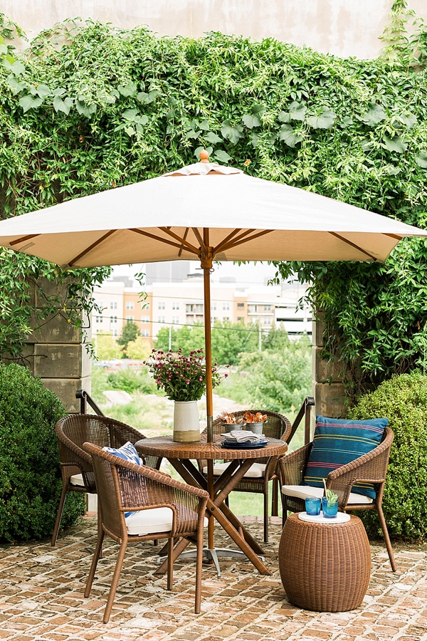 Outdoor patio dining set and umbrella at an end-of-summer block party with Pottery Barn, @waitingonmartha