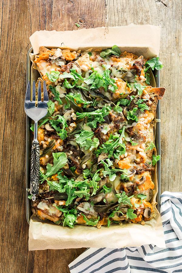 Fall nachos with sweet potato, caramelized onions and arugula. Recipe by @waitingonmartha