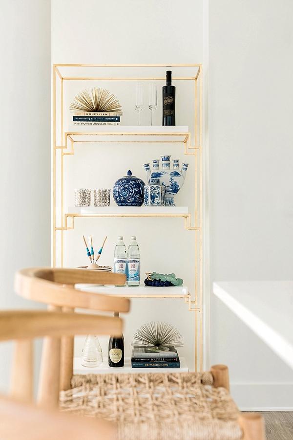 Gold and white bookshelf, @waitingonmartha