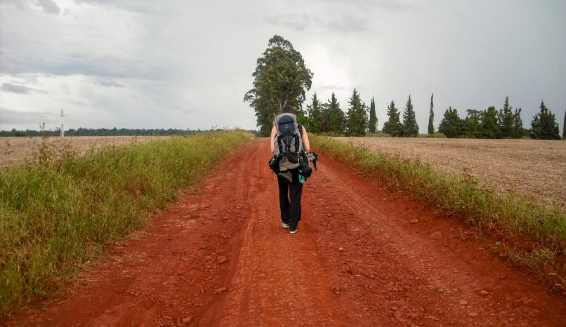 walking away with backpack