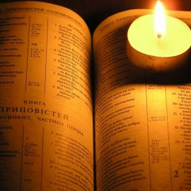 Bible and candle Wallpaper