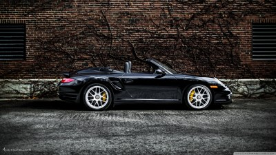 Black 2012 Porsche 911 997 Turbo S Cabriolet by a brick wall covered in vines 4K HD Desktop ...