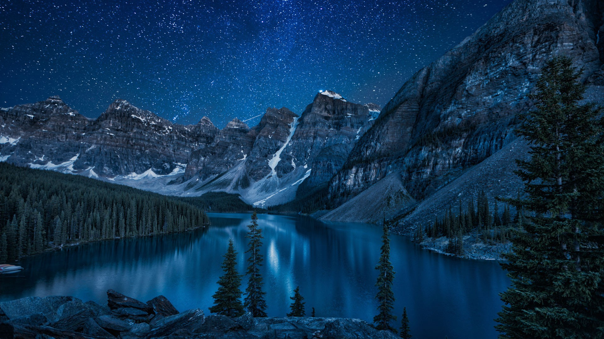 moraine lake at night snowy landscape in the mountains canada
