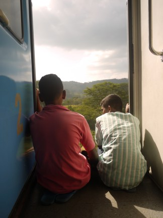 Best seats in the house, admiring the view from the train door, Sri Lanka