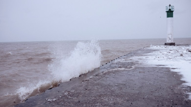 A wave breaking against the pier.