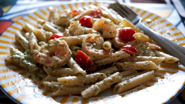 Penne with creamy pesto, shrimps, and sweet tomatoes. Yum!