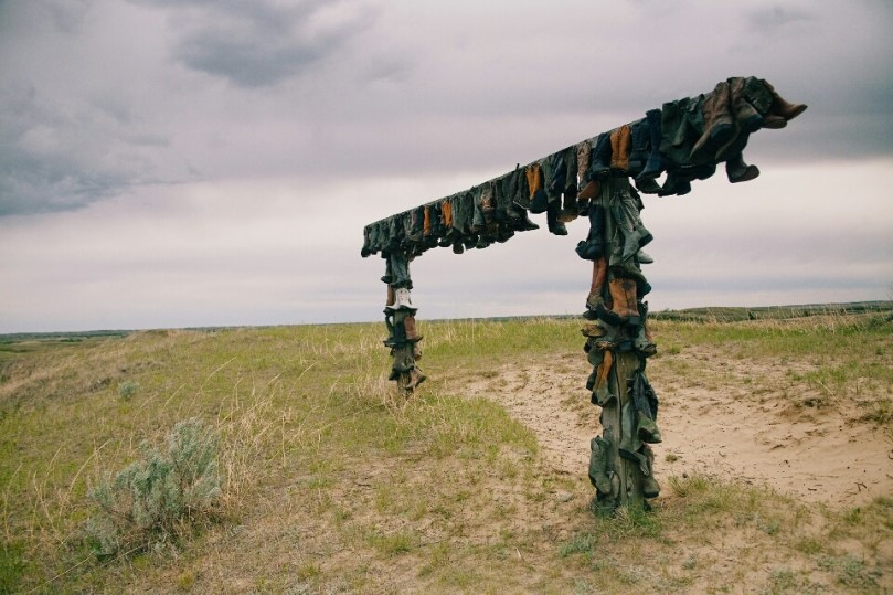 A great collection of cowboy boots on top of a hill in the Great Sand Hills.