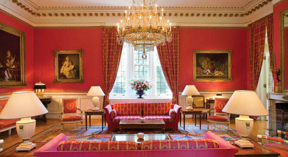 "The red ""grand salon,"" one of the masterpieces of the residence, boasts a painting by Bonnard."