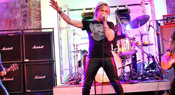 Charm City Devils' lead singer John Allen rocks out during the Pink Fashion Rocks event