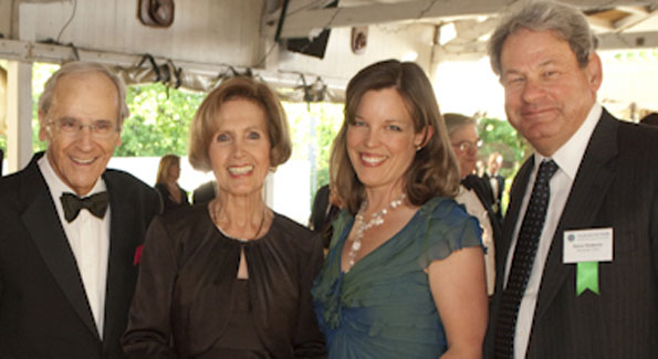 """Ambassador Connie Morella and her husband, Tony; Christine Enemark, Gala Co-Chair; and Steve Roberts at the Gala in the Park reception in the the """"Bumper Car Pavilion."""""""
