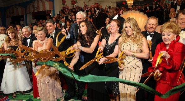The Greenbrier's owner Jim Justice, center, leads Brooks Shield, Jessica Simpson, Barbara Eden, Shaquille O'Neal and other celebrities in a star-spangled opening of the new Casino Club.   Courtesy Photo/The Greenbrier