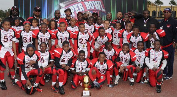 The Beacon House Junior Pee Wee Falcons bring home the Pop Warner Superbowl trophy. (Photo courtesy of Beacon House)