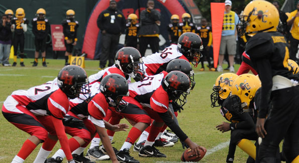 The Beacon Hill Falcons (in red, white and black) crushed the Liberty City Warriors (in yellow and black) 19-0 to win the Pop Warner Junior Pee Wee Superbowl championship. (Photo courtesy of Beacon House)