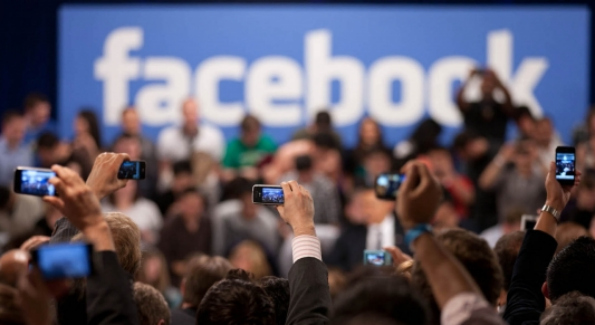 Members of the audience take pictures as President Barack Obama participates in a town hall meeting moderated by CEO Mark Zuckerberg at Facebook headquarters in Palo Alto, Calif. April 20, 2011. (Official White House Photo by Lawrence Jackson)