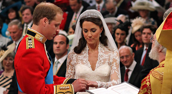 Prince William placed the ring on Kate Middleton's finger before the Archbishop of Canterbury. Credit: Dominic Lipinski/Agence France-Presse — Getty Images