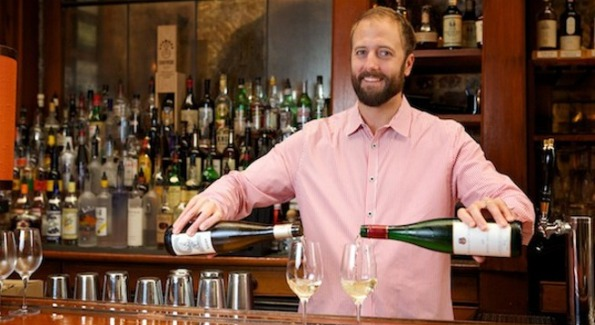 Clint Sloan, sommelier at McCrady's and Husk in Charleston, pours glasses of riesling for Summer of Riesling 2011. Photo courtesy of Charleston City Paper.