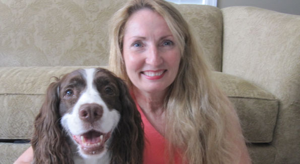 """Who rescued whom?"" many rescue dog owners ask themselves. Pictured here is Sandye Blalock with her rescue Springer Spaniel Princess Grace, who now rules the house."