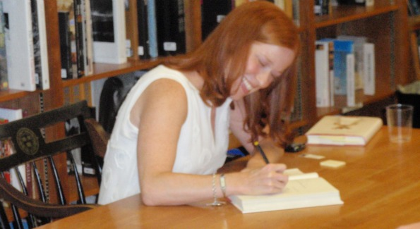 Jennifer Close signs books and chats with readers at the reading for her debut novel.