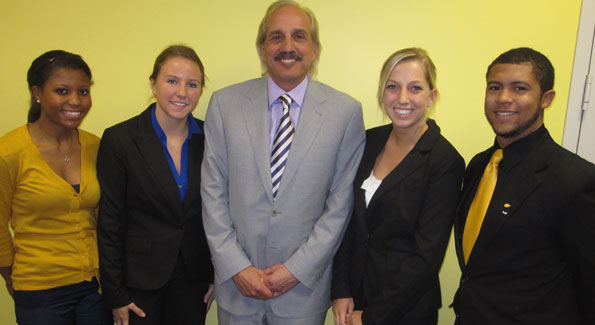 Taylor Conley, McKenya Klemz, Sarah Hess and James Adams, Alpha Kappa Psi students from the University of Toledo, flank Tom Raffa (center), CEO of RAFFA and founder of Companies for Causes.