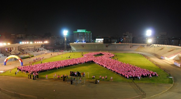 The world's largest human pink ribbon. (Photo by)