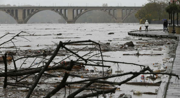 The damage to the Georgetown waterfront after Hurricane Sandy included a debris-filled Potomac River. (AP Photo/Jacquelyn Martin)