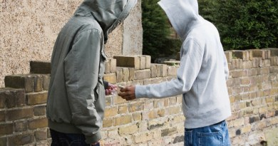 Teenagers passing drugs --- Image by © Image Source/Corbis