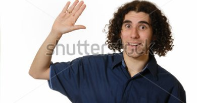 stock-photo-young-man-raising-hand-in-high-five-tentative-wave-isolated-on-white-8063188