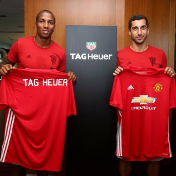 Ashley-Young-and-Henrikh-Mkhitaryan-show-off-TAG-Heuer-branded-jersey