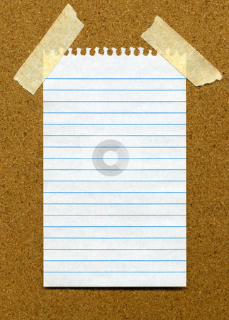 White lined blank paper stuck to a cork noticeboard stock photo