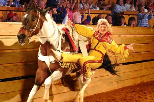 Female Horse Rider performing tricks at the Dixie Stampede in Pigeon Forge