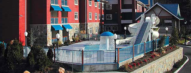 Overview of the Outdoor Pool, zero entry access and water slide at the Fairfield Inn and Suites Gatlinburg North wide