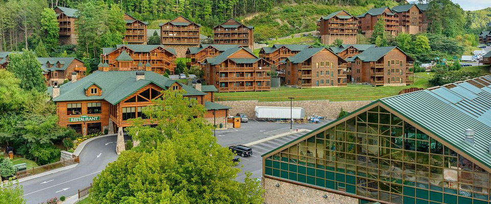 View of the Entrance to the Westgate Smoky Mountain Resort with Check-in on the Left and the Indoor Water Park Roofline on the right 960