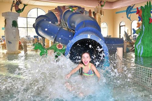 Splashdown from the Water Slide at the Indoor Waterpark Atlantis Hotel Wisconsin