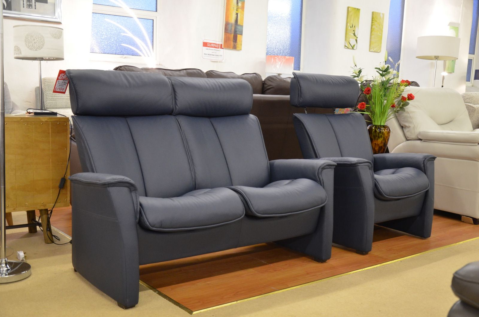 Blue Leather Two Seater Sofa And Armchair With Push Back Recliners