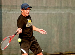 Webster University senior Diego Alarcon readies to swing a forehand during his match against Washington University in Clayton, Mo., on Friday, March 29. Alarcon lost both his matches on March 29, and Webster lost overall 9-0 to the Bears. The loss snapped Webster's program-record 13 consecutive match win streak. CONTRIBUTED BY MACKENZIE WILDER.